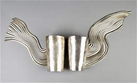 144 A fine pair of Herv van der Straeten silvered met