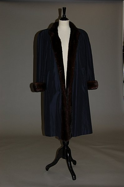 2017: A dark brown mink lined navy raincoat, 1980s, che