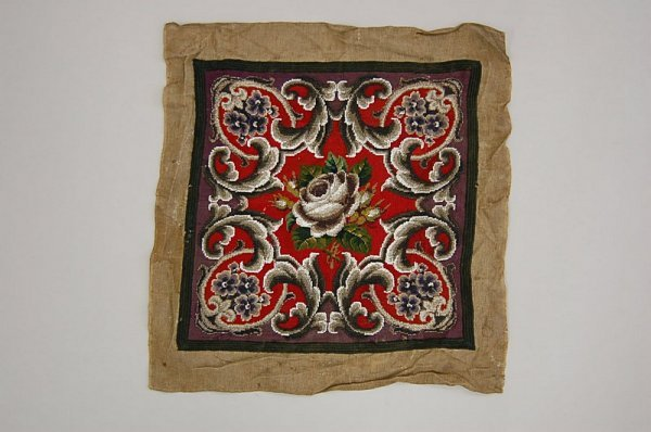 2023: A beadworked and Berlin woolworked cushion panel,