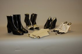 2: A group of Chanel footwear, comprising: black leathe