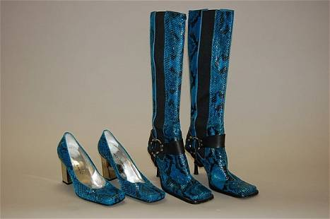 A pair of blue snakeskin Dolce and Gabbana boots, wi