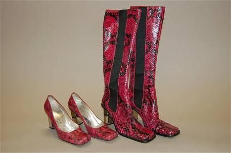 A pair of bright pink Dolce and Gabbana snakeskin bo