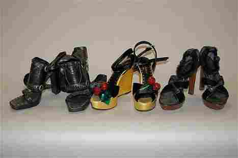 Three pairs of Yves Saint Laurent shoes, comprising