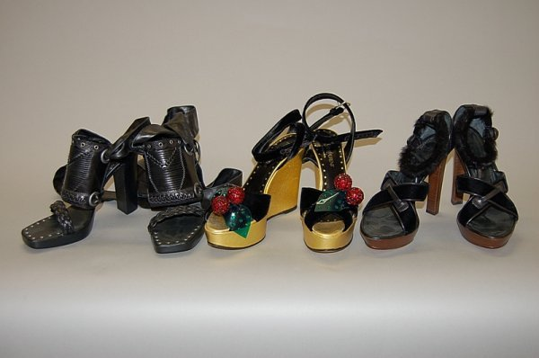 12: Three pairs of Yves Saint Laurent shoes, comprising