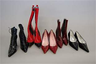 A group of Dolce and Gabbana footwear, mainly red a