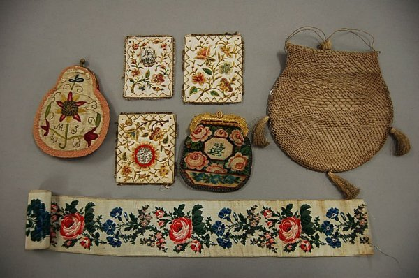 1: A group of purses, comprising framed silk with flora