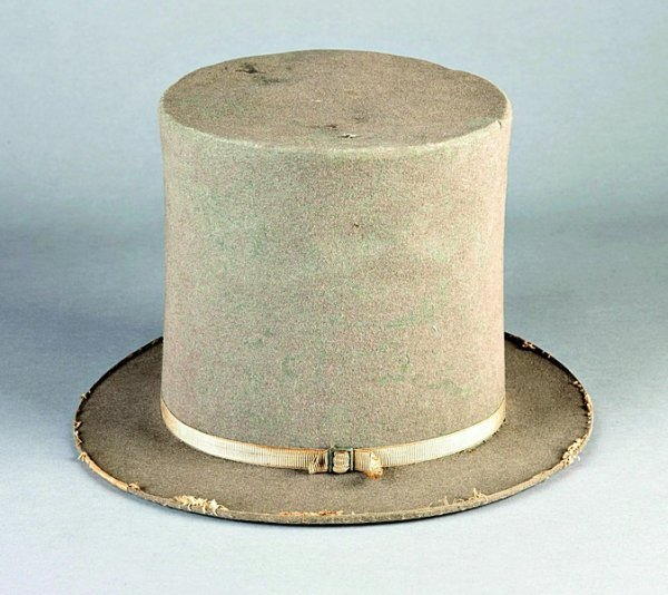 12: A Gentleman's stove-pipe hat, 1860s of grey felt wi
