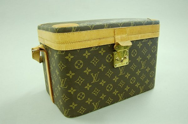 15: A Louis Vuitton vanity case, 1980s, with LV printed