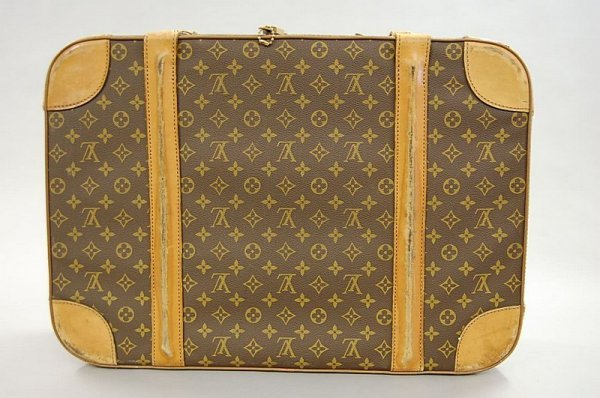 16: A Louis Vuitton soft-sided suitcase, probably 1960s