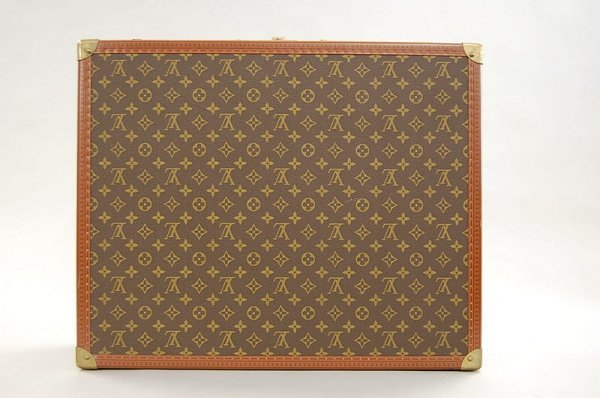 17: A Louis Vuitton hard sided suitcase, probably 1960s
