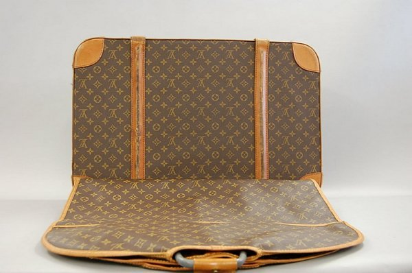 18: A Louis Vuitton suit carrier, probably 1960s, with
