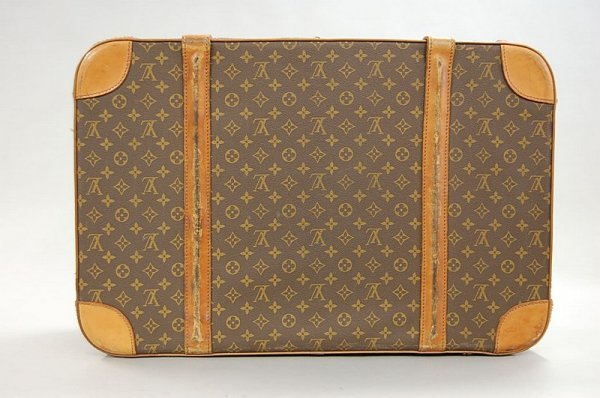19: A Louis Vuitton soft-sided suitcase, probably 1960s