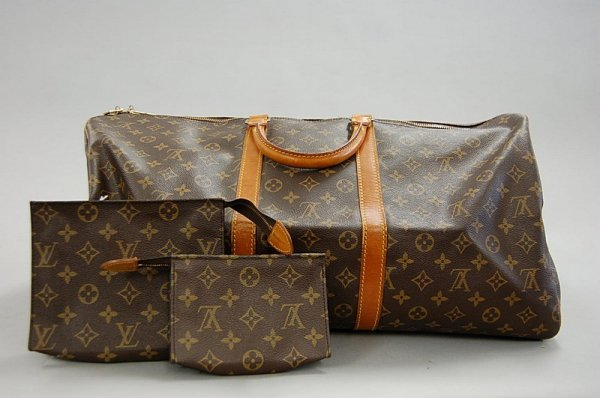 20: A Louis Vuitton over-night bag, French, 1980s, in L