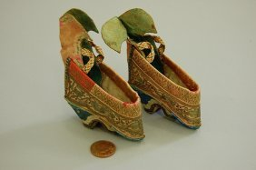 1001: A pair of tiny lotus-bud slippers for bound feet,