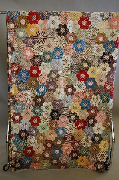 1009: An unfinished patchwork coverlet, the patches mai