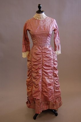1017: A pink taffeta gown, circa 1880, altered from an
