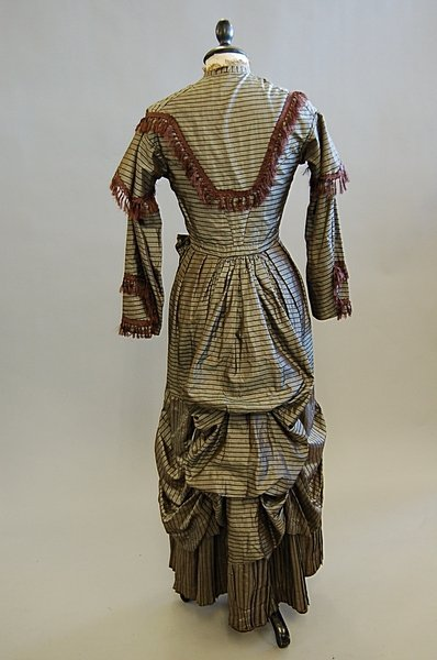 1018: A brown striped taffeta gown, late 1860s, altered
