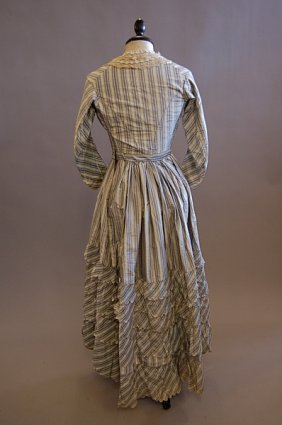 1019: A striped grey and blue taffeta gown, 1860s, with