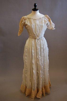 1021: A cream striped silk gauze summer gown and a bonn