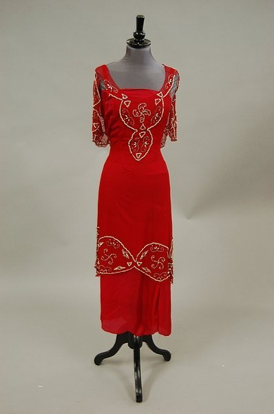 10: A scarlet chiffon tunic, 1920s, with associated red