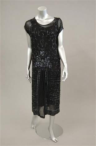 A beaded and sequined black georgette cocktail dres