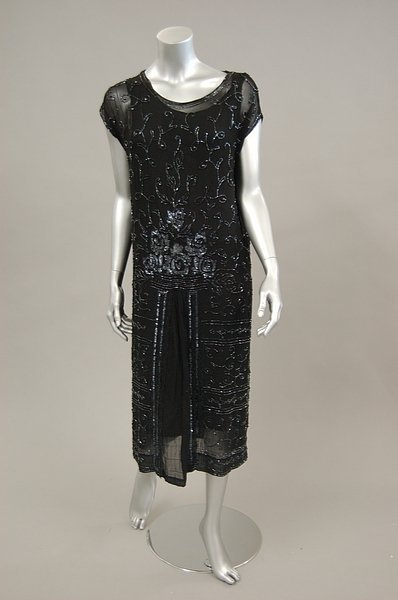12: A beaded and sequined black georgette cocktail dres