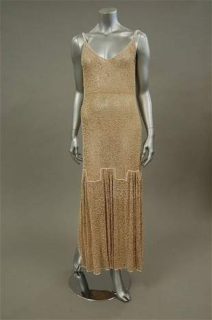 A beige lace and white beaded evening gown, circa 1