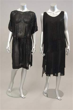 Two flapper dresses, late 1920s, the first of black