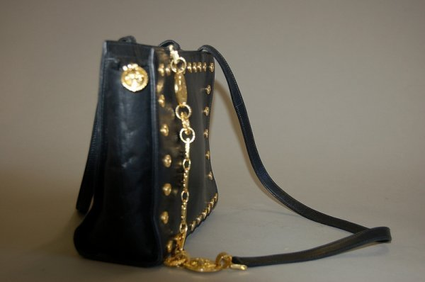 1006: A Gianni Versace couture black leather handbag, 1