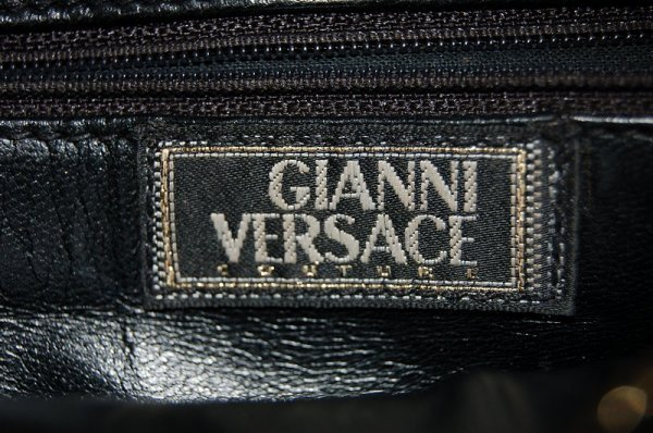 1006: A Gianni Versace couture black leather handbag, 1 - 2