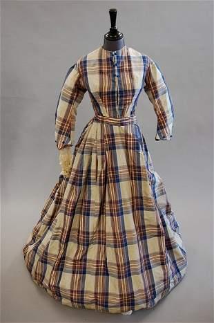 A tartan taffeta gown, mid 1860s, with blue silk