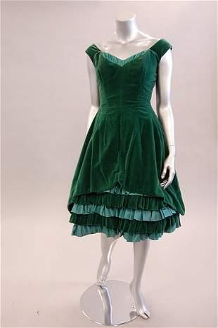 A green velvet evening dress circa 1955-7, labell