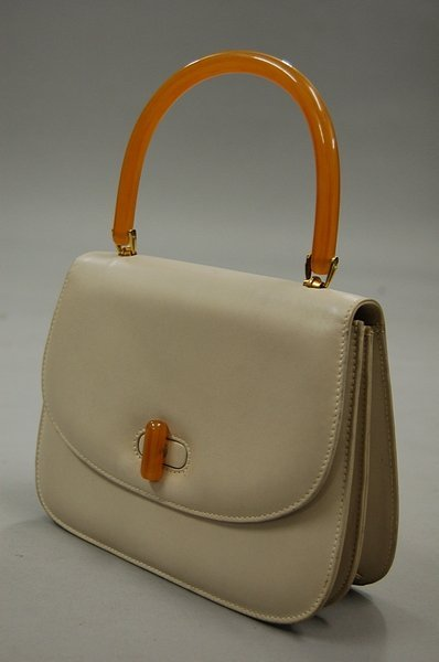 1: A Gucci leather handbag, 1960s, of bone-coloured lea