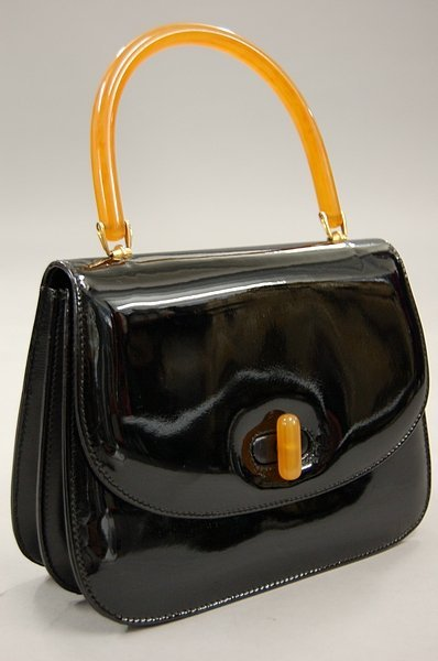 6: A Gucci black patent leather handbag, 1960s, with ce