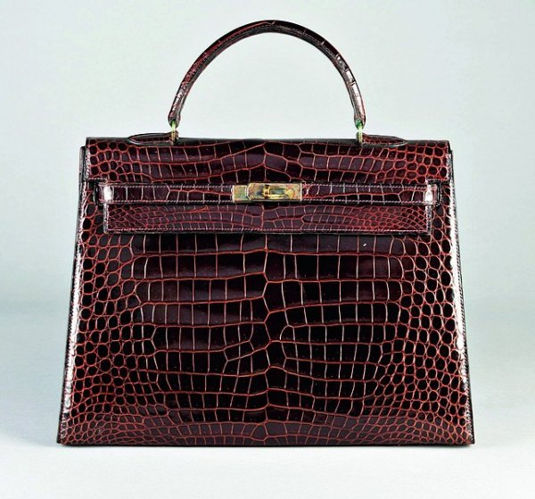 7: A fine Hermès chocolate brown crocodile Kelly bag, 1