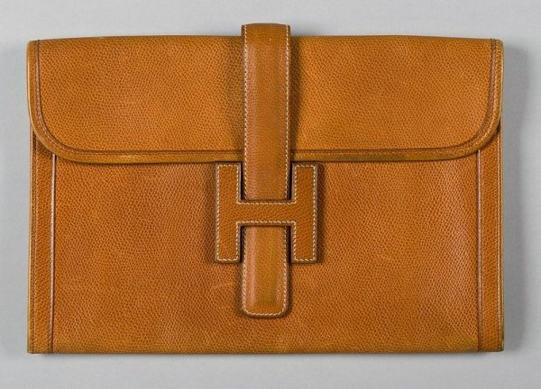 12: An Hermès tan-brown pig-skin clutch bag, probably 1