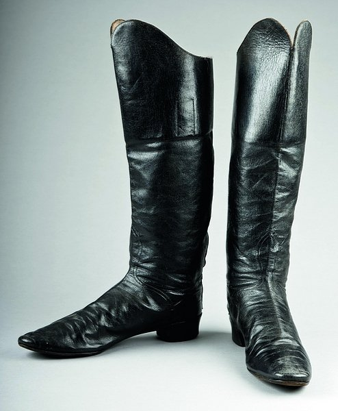 17: A pair of black leather boots, 1850s-60s, left and