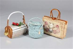 A group of straw hats and summery handbags, mainly