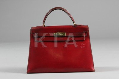 An Hermes burgundy leather Kelly bag, 1960s, stamped in