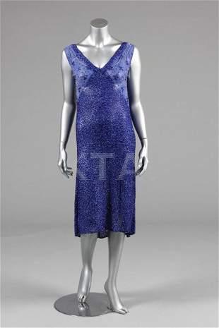 A sapphire-blue beaded chiffon flapper dress, late
