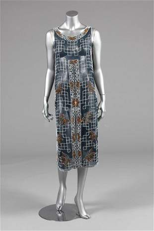 A beaded tunic-dress, late 1920s, of midnight-blue
