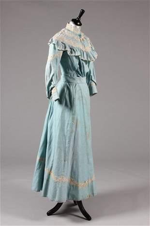 A blue figured cotton summer gown, circa 1900, the