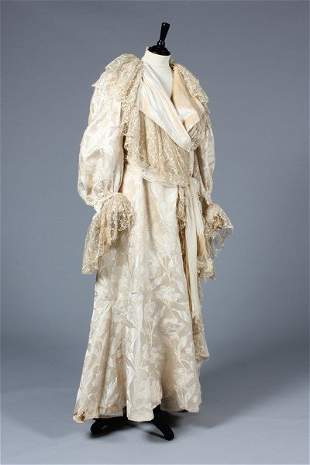 A poor condition Charles Frederick Worth ivory damask