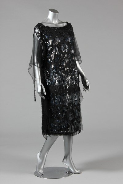 A sequinned black tulle tabard dress, early 1920s, the