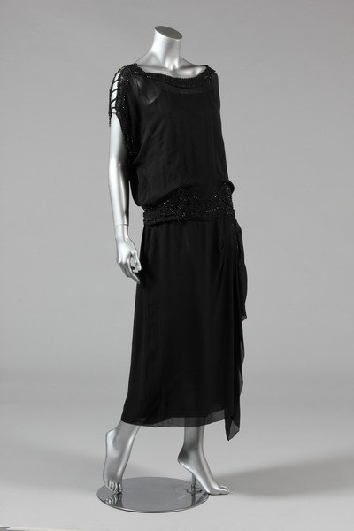 A sequinned black tulle tabard dress, early 1920s, the - 2
