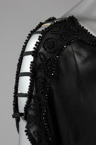 A sequinned black tulle tabard dress, early 1920s, the - 7