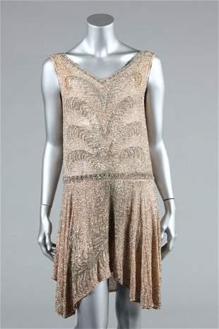 A pale pink beaded muslin flapper dress, circa 1928,