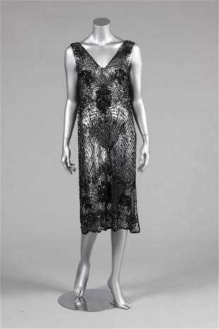 A black sequined tabard circa 1918-20, the tulle ground
