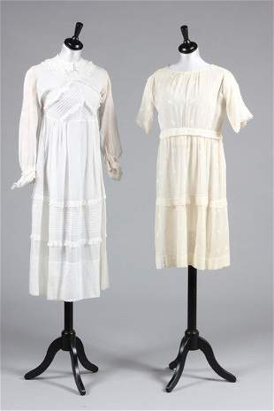 Two muslin girl's dresses, circa 1918 and 1928,