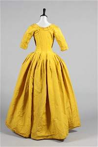 A Chinese-yellow silk open-robe, circa 1770, with